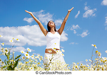 Praising - Image of happy female standing with raised arms...