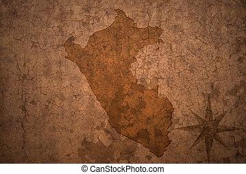 peru map on a old vintage crack paper background