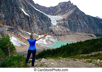 Woman in front of glacier lake. - British Columbia. Canada.