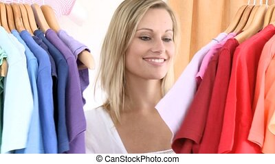 Caucasian woman selecting item in a clothes shop