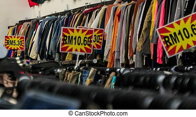 View of Racks with Different Jeans in Shop - closeup view of...