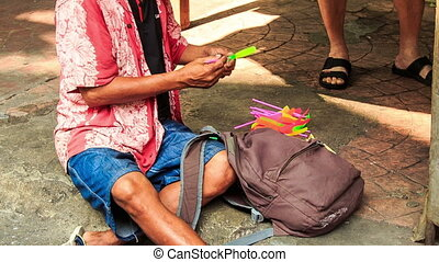Street Vendor Launches Toy Helicopter Sitting on Pavement -...