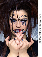 spider girl - close up portrait of girl with spider bodyart...