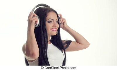 woman listening to music on headphones - portrait of...