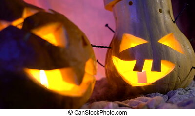 Funny pumpkin head the company during the night Halloween....