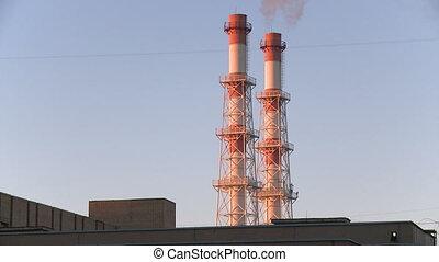 Smoke stacks of factory and sky