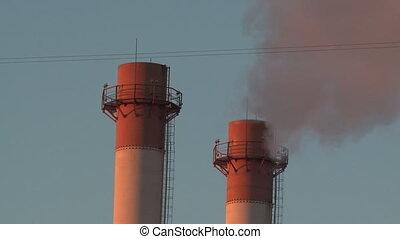 Smoke stacks and sky - Smoke stacks of factory at sunset
