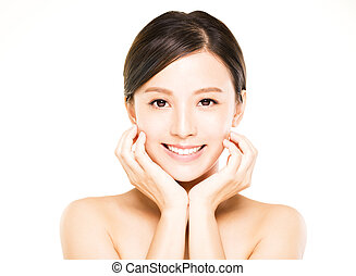 closeup young woman face with clean skin