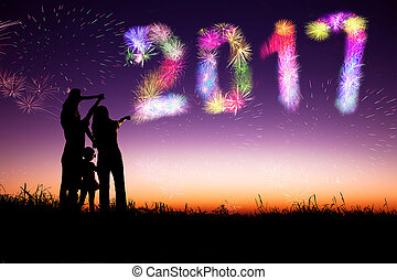 family watching fireworks and happy new year 2017 concept