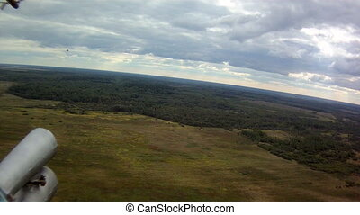 View from window of helicopter - View on forest and meadow...