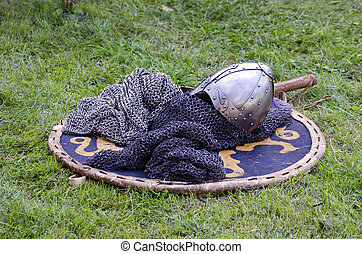 Knight armor headpiece on shield - Knight armor headpiece...