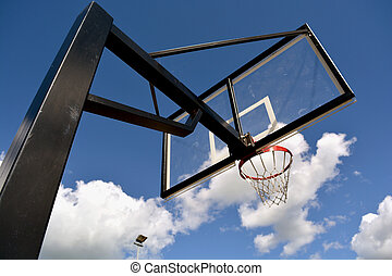 Basketball stand against sky - Basketball stand with a hoop...