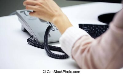 woman calling on telephone at office - business, people,...
