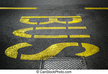 Bus stop sign - Yellow bus traffic sign painted on asphalt...