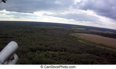 Helicopter flight. Aerial view of forest - Helicopter...