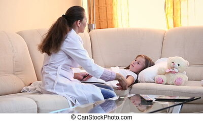 doctor examines a child - doctor examines a little girl