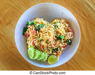 Fried rice on the wooden table.
