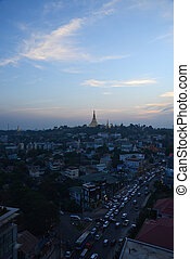 shwedagon pagoda surrounded by houses in yangon