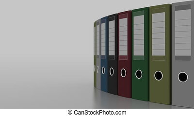 Colored office binders rotation, shallow focus. 4K seamless...