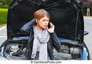 Car is broken - Picture of a helpless young woman with her...