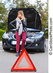 Unhappy woman with broken car - Picture of a helpless young...