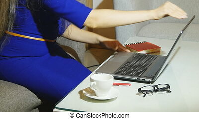 beautiful young woman is seating indoors at a cafe...
