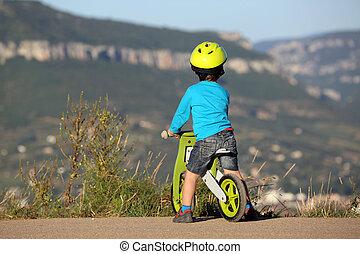 Little Boy Riding Wooden Bike - Little Boy Is On A Bike And...