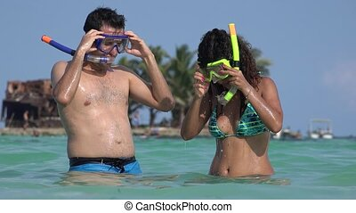 Swimmer Tourists In Ocean With Snorkels
