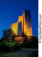 Business building in the evening in the city Groningen