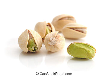 Pistachios - Extreme close-up image of pistachios on white...