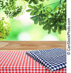 checkered tablecloth and blur leaves background