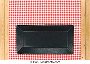 dish on checkered tablecloth