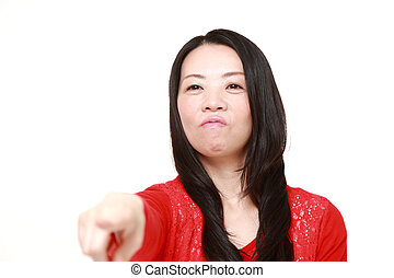 Japanese woman scolding - concept shot of Japanese woman's...