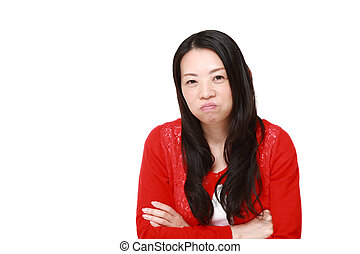 Japanese woman in a bad mood - concept shot of Japanese...