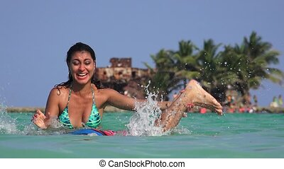 Man And Woman Having Fun Playing In Ocean Water On Summer...