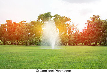 Fountains in park with burst light
