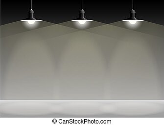 Ancient three black lamp hanging. Big and empty space illuminated on the grey wall.