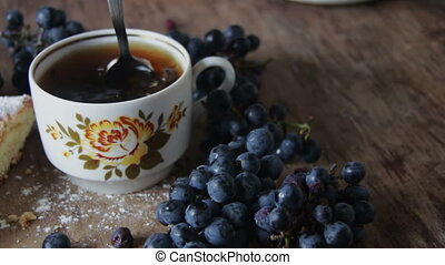 cup of hot black leafy tea - cup of hot black tea with...