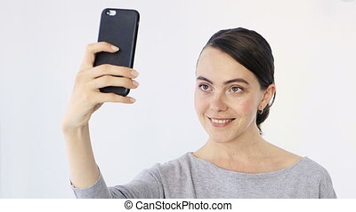 Smiling lady doing selfie on a white background