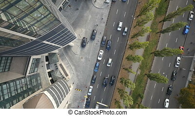 aerial flight cityscape over buildings looking down cars