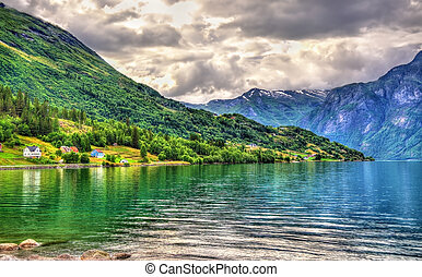 Oppstrynsvatn lake at Oppstryn village, Norway -...
