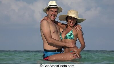 Happy Couple Posing In Swimwear And Bikini On Summer...