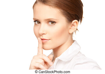 finger on lips - bright picture of teenage girl with finger...