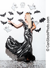 Full length of beautiful blonde young woman with halloween...
