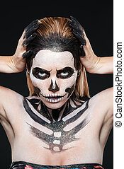 Woman with skeleton halloween makeup