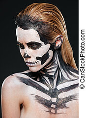 Woman with frightening scared makeup over black background