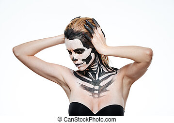 Portrait of young woman with frightening halloween makeup