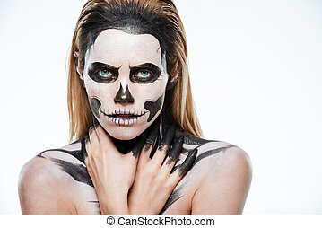 Portrait of girl with fearful skeleton makeup over white...