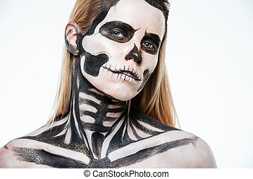 Closeup of woman with halloween skeleton makeup over white...