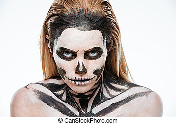 Portrait of woman with terrifying halloween makeup over...